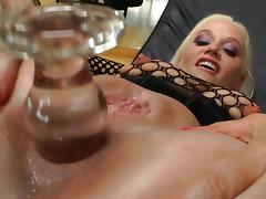 Impassioned solo model in fishnet pantyhose masturbating with monster toys