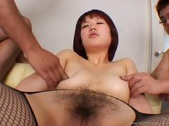 Asian milf wearing fishnet pantyhose gets her hairy twat banged in MMF