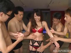 Inviting Japanese babe getting fingered by a group before receiving facial cumshot