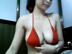 Webcam - Busty young Asian girl teasing (no sound)