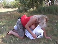 Busty blonde milf fucks her hubby's asshole with a dildo outdoors