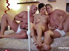 Bubbly brunette cowgirl in high heels gives a blowjob then gets screwed in a hot mmf threesome