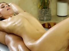 Petite cowgirl with small tits gets fucked doggy style after giving an oily massage