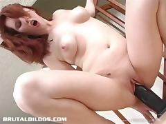 Redhead with natural tits and tramp stamp toy fucking her cunt