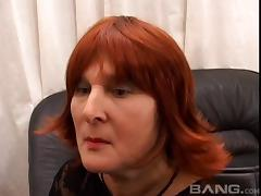 Mature woman with long red hair enjoying a hardcore doggy style fuck