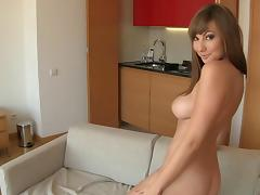 Bubbly solo model with big tits masturbates in the kitchen
