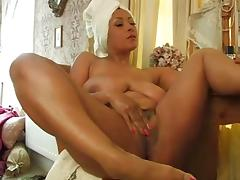 Hot MILF playing with her twat and boobs