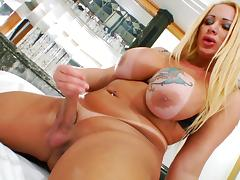 Shemale hooker with big tits jerks off her hard cock