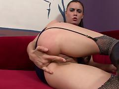 She fingers her pussy while using her free hand to finger her ass