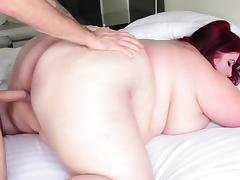 Fat babe with massive tits and huge curves gets poked by a horny stud