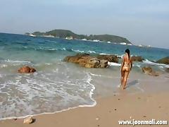 thai girl joon mali teasing on the shore