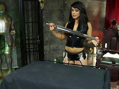 A mistress takes her female slave to the dungeon and works her pussy