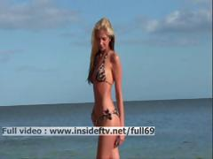 Suzanna Amateur blonde acting naughty on a public beach