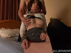 An Asian slave girl in a collar and cuffs gets licked and fucked