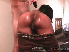 Fine ass African chick pounded doggy style on a leather sofa