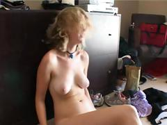 Suntanned Adele is on her webcam and does a little striptease