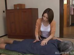 A sexy, curvy Japanese girl grinds on this guy's cock