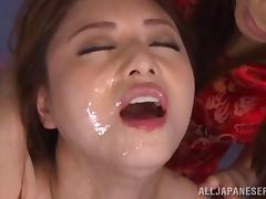 Masked men coat her pretty Japanese face in loads of cum