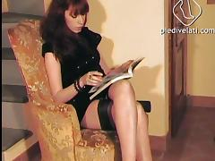 Foot fetish in black erotic stockings for a hot redhead