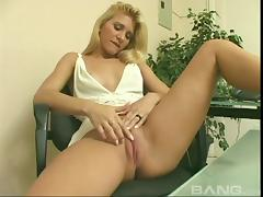 She lifts up her dress and rubs her smooth, fully shaved pussy