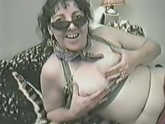 A retro video of a mature woman with small tits fucking