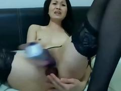 Thai Chick In Stockings Fucking Herself With Dildos