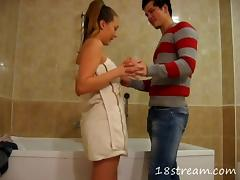 Her perky teen tits are incredible in a bathroom doggystyle video