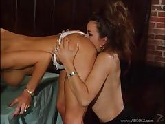 Lesbian babes double penetrate each other with their toys