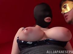 Big tits Asian in a mask moans while getting stroked with a toy