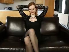 Redhead slut fondles her big juggs and beaver