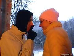 Girlfriend with glasses gives outdoor blowjob on a snowy day