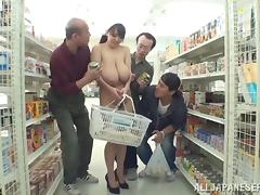 A wild, busty Japanese girl shops nude and fucks in the store