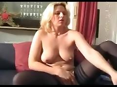 Blonde german fucks herself with a huge black toy