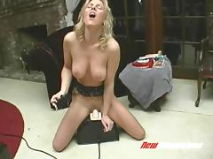 Screaming like crazy as she rides a big sex machine