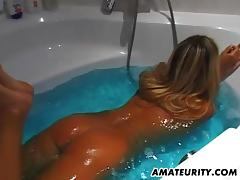 Hot ass blonde amateur fondles her natural tits while taking a hot bath