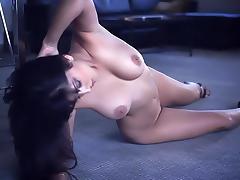 Palpitating brunette showcasing her big tits before masturbating
