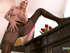 Cougar in nylon pantyhose wears outfits and spreads legs in solo scene
