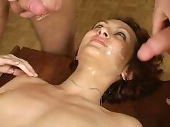Wavy haired solo model takes on two cocks in a sizzling threesome