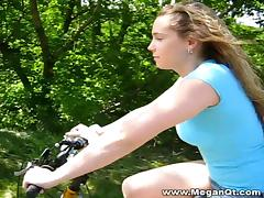 Nice ass cowgirl takes a ride on a bike before showing off her nice ass  outdoors