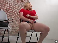 A chunky girl with big tits gives head in a gloryhole
