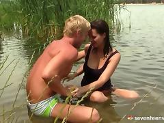 After a swim in the lake she pulls down his trunks and blows him