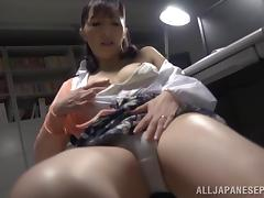 A Japanese coed takes a break from homework to rub her pussy