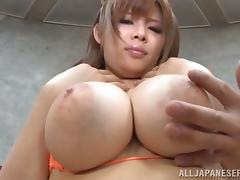 He lays his cock between Ramu Hoshino's great tits and fucks them