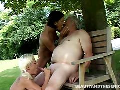 Two sexy younger chicks fuck a very lucky older gardener