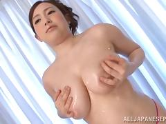Big boob Asian woman gives a tremendous titjob before fucking