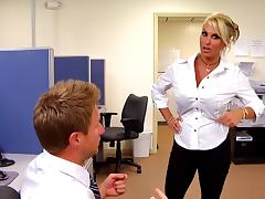 Busty blonde co-worker gets fucked in the middle of the office