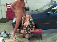 Milf climbs in the hood of his car and gets pounded on