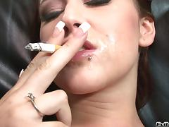 Accepting babe smokes cigar after riding a beefy white cock