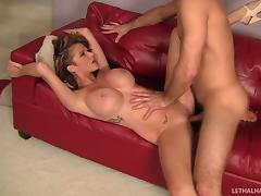 Wavy haired milf with fake tits loves being pounded doggy style