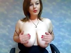 Busty redhead strips her clothes on webcam